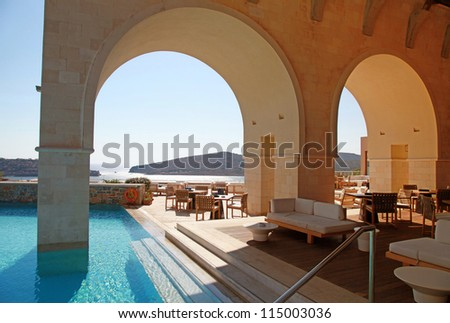 Beautiful Mediterranean sea view with arch pool terrace on summer luxury resort (Greece) - stock photo