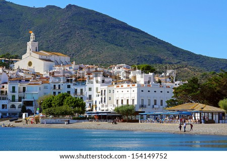 Beautiful Mediterranean village of Cadaques with its church and casino, Catalonia, Costa Brava, Spain - stock photo