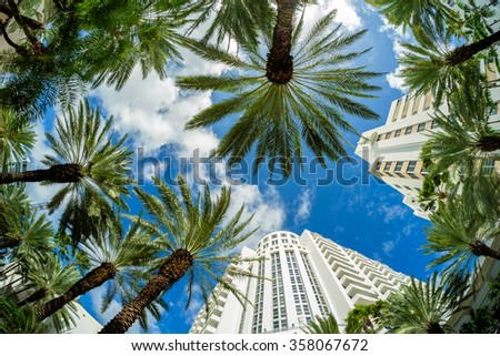 Beautiful Miami Beach fish eye cityscape with art deco architecture and palm trees. - stock photo