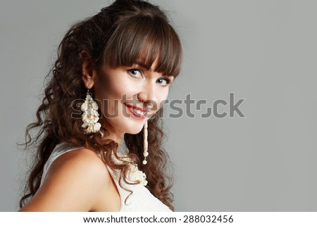 beautiful middle age woman headshot over grey background - stock photo