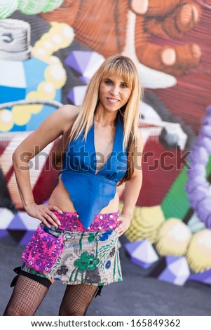 Beautiful middle age woman outdoor urban portrait.