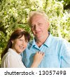 Beautiful middle-aged couple in love outdoors - stock photo