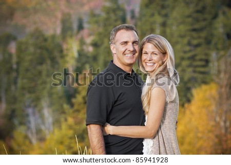 Beautiful Middle-aged Couple Outdoors Portrait - stock photo