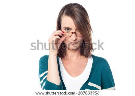 Beautiful middle aged woman adjusting her eyeglasses - stock photo