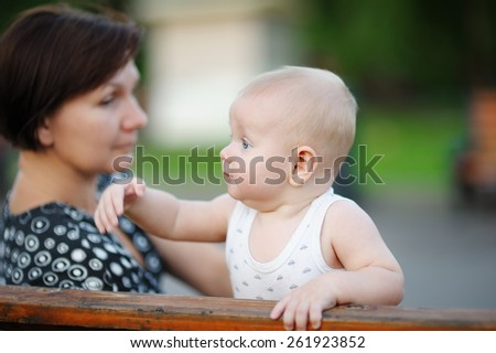 Beautiful middle aged woman and her adorable little grandson at the city - stock photo