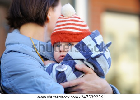 Beautiful middle aged woman and her adorable little grandson outdoors - stock photo