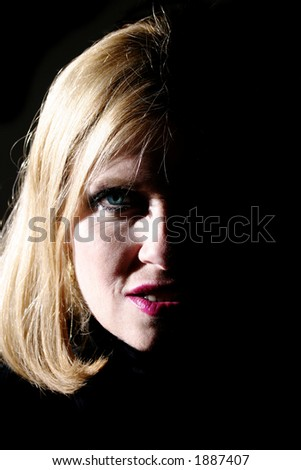 Beautiful Middle Aged Woman Caught in Sexy Lighting. - stock photo