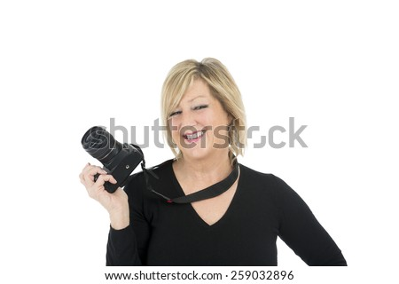 Beautiful middle aged woman holding a professional camera against a white background - stock photo