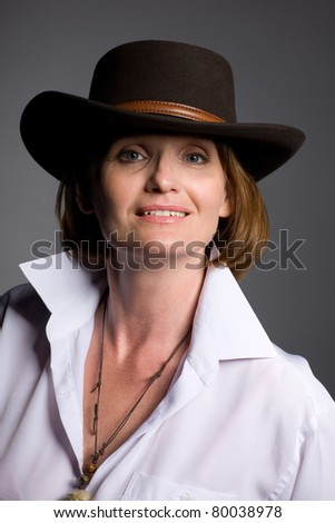 Beautiful middle aged woman in a hat. - stock photo