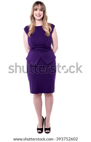 Beautiful middle aged woman posing to camera in party wear.