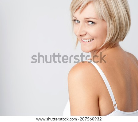 Beautiful middle aged woman smiling warmly - stock photo