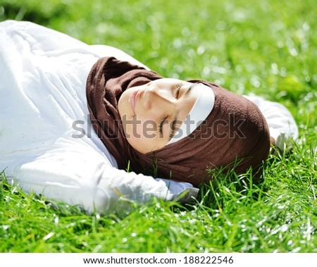 Beautiful Middle Eastern Arabic girl having relaxing time in nature - stock photo
