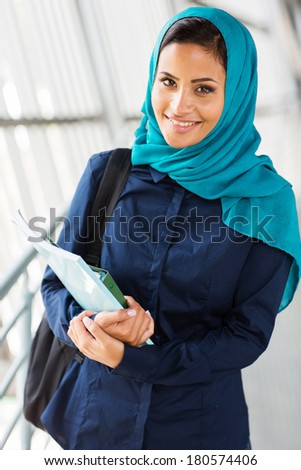 beautiful middle eastern college girl holding books - stock photo