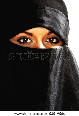 Beautiful Middle eastern woman in niqab traditional veil with High Contrast effect against a white background - stock photo