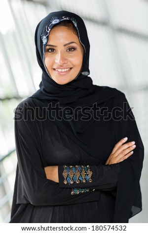 beautiful middle eastern woman with arms crossed - stock photo