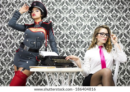 beautiful military boss and her sexy secretary - stock photo