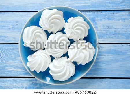 beautiful mirengue on wooden surface - stock photo