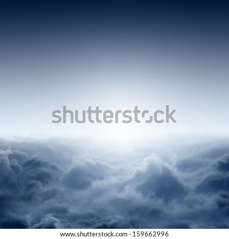 Beautiful misty sunrise from aerial view, view on clouds from above, bright sun - stock photo