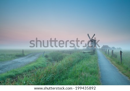 beautiful misty sunrise over Dutch farmland, Holland - stock photo