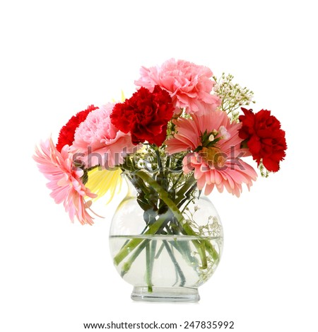 Beautiful mix flowers in glass vase isolated on white  - stock photo
