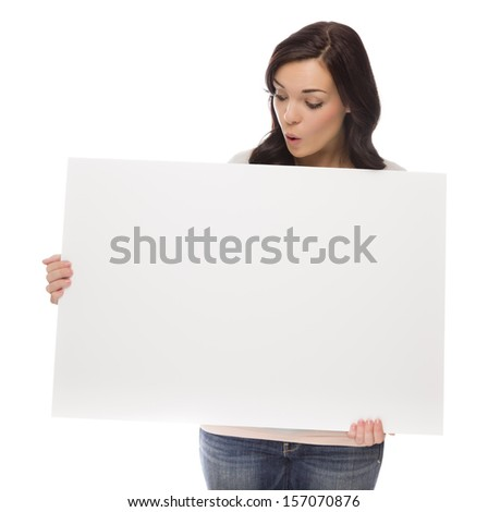 Beautiful Mixed Race Female Holding and Looking at Blank Sign Isolated on a White Background.   - stock photo