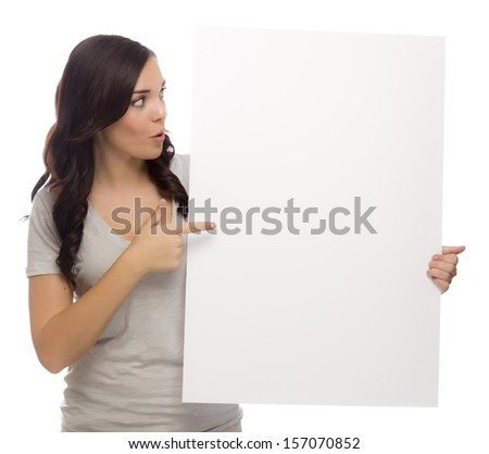Beautiful Mixed Race Female Holding and Pointing Blank Sign Isolated on a White Background.   - stock photo