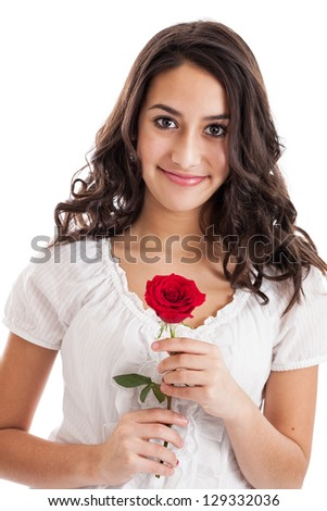 Beautiful mixed race tween girl holding a red rose portrait isolated on a white background - stock photo