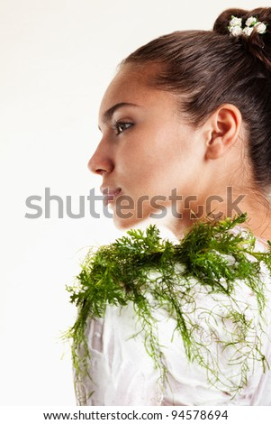 Beautiful Mixed race Woman with Seaweed Body Mask and Seaweed pants isolated on white background - stock photo
