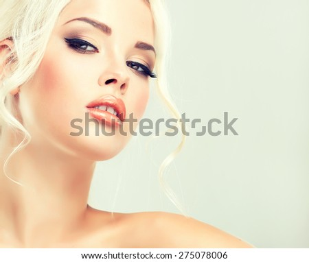 Beautiful model blonde with retro hair , bouffant hair, and a bushy tail . Hair style like Brigitte Bardot .  - stock photo