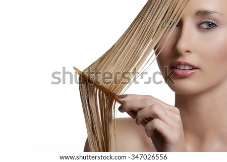 beautiful model comb wet hair  after washing on white