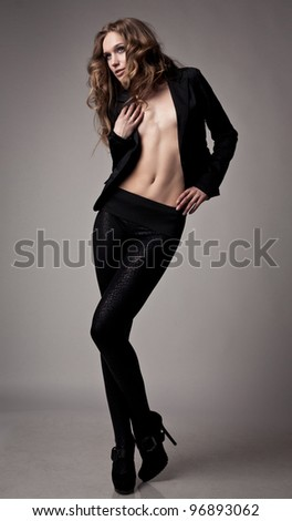 beautiful model dancing on grey background