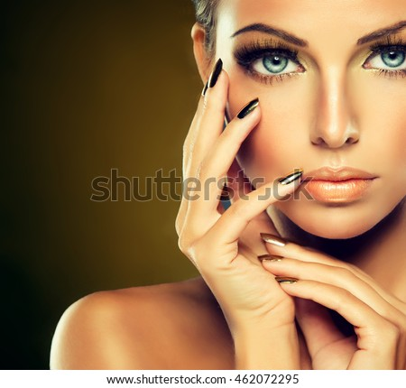 beautiful model girl golden makeup gold stock photo