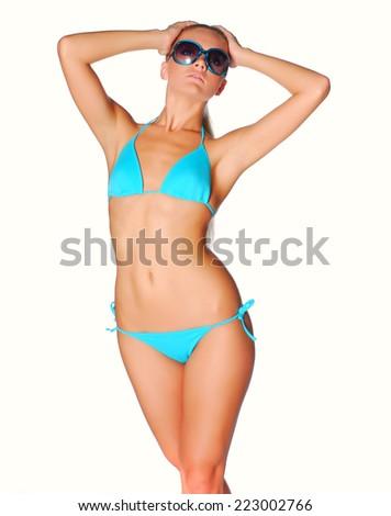 Beautiful model in bikini. Isolated on white background. - stock photo