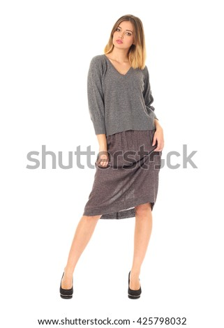 Beautiful model in skirt isolated on white - stock photo