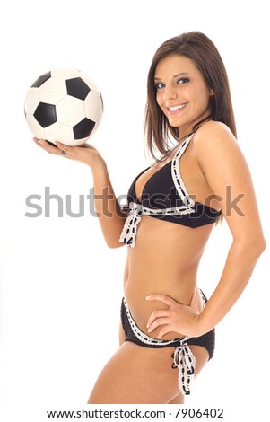 beautiful model in swimsuit with soccer ball - stock photo
