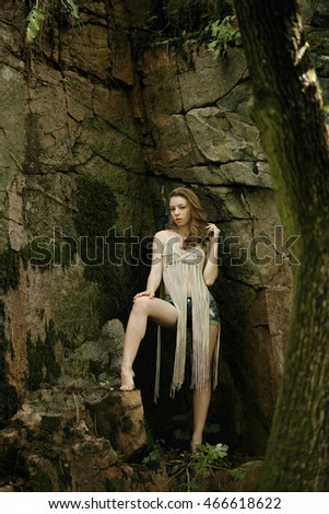 Beautiful model in the wild tropical forest. Tourism. Nature. Fashion concept