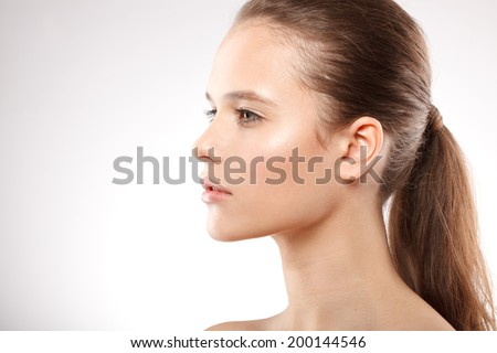 beautiful model lady with natural make-up and brunette hair studio fashion shot on white background, perfect skin - stock photo