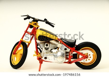 Beautiful Model Motorcycle Chopper on a White Background - stock photo