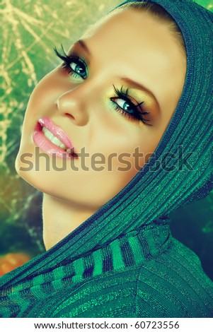 Beautiful model on gold background in blue christmas fashion. - stock photo