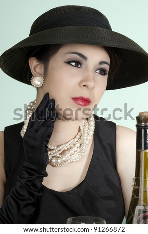 Beautiful model wearing retro hat and gloves - stock photo