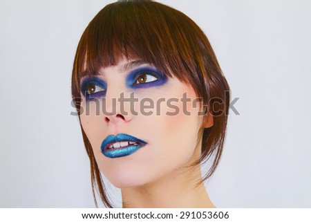 Beautiful Model With Bright Blue Makeup - stock photo