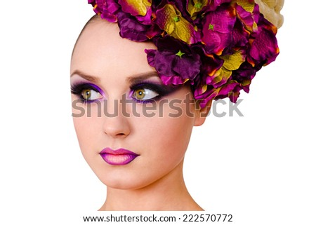 Beautiful model with decorative make up and high hairstyle of purple flowers  isolated on white background
