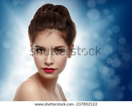 Beautiful model with elegant hairstyle. Christmas background. Winter theme. - stock photo