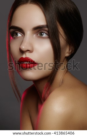 Beautiful model with fashion make-up. Close-up portrait sexy woman with glamour lip makeup and bright eye shadows. Macro shot of celebrate visage, clean skin, lips with red lipstick, eyeshadows  - stock photo