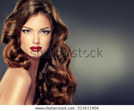 Beautiful model with long curly hair . fashion trend image ,the girl with blue eyes , fashion makeup and Hairstyle curls - stock photo