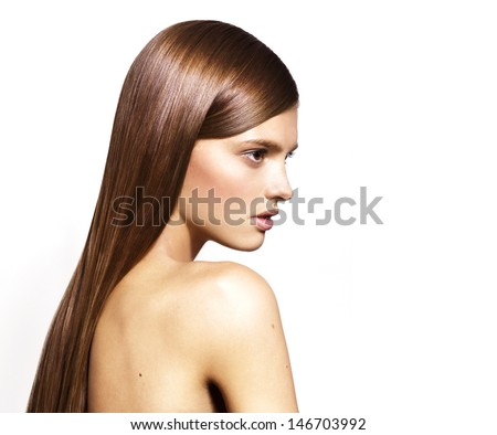 Beautiful model with long shiny hair isolated on white background - stock photo