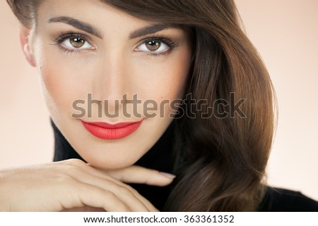 Beautiful model with matte red lipstick. Fashion and beauty concept in studio.  - stock photo