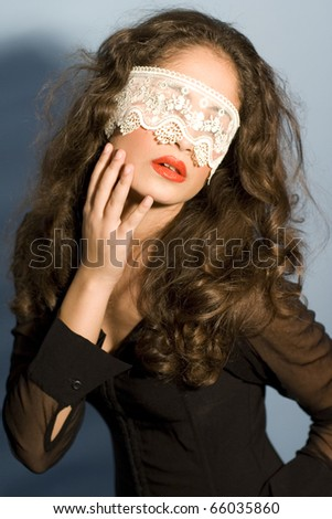 beautiful model with red lips posing fashion in studio with lace - stock photo