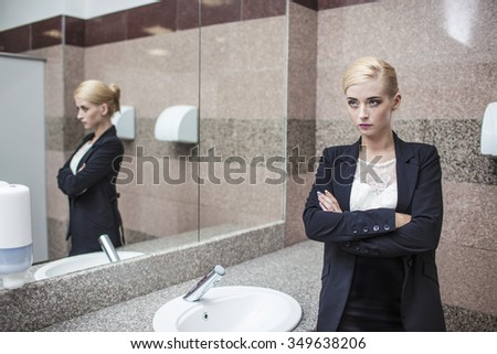 public bathroom mirror. Beautiful Model Woman Businesswoman In Business Attire The Mirror Bathroom Public