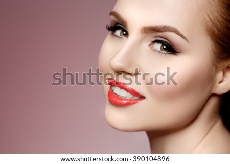 Beautiful model woman in beauty salon makeup Young modern girl in luxurious spa Lady make up Mascara for long lashes lipstick on lips eye shadow shiny hair manicure with nail polish Products Treatment - stock photo